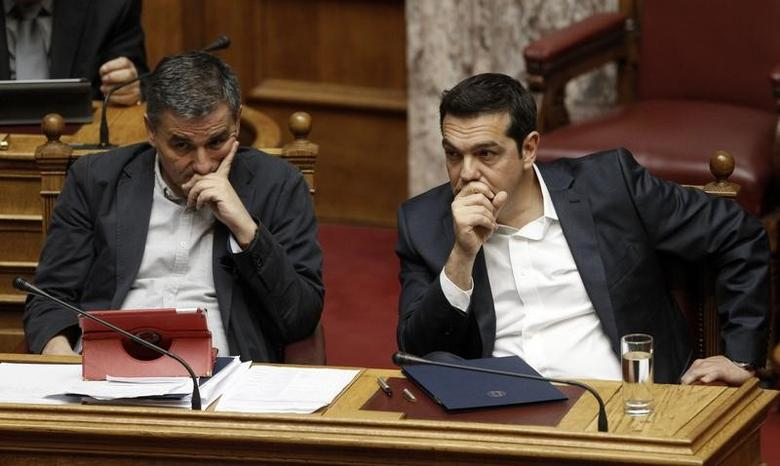 FILE PHOTO: Greek Prime Minister Alexis Tsipras and Finance Minister Euclid Tsakalotos attend a parliamentary session, before a vote on a new package of tax hikes and reforms in Athens, Greece, May 22, 2016.    REUTERS/Michalis Karagiannis
