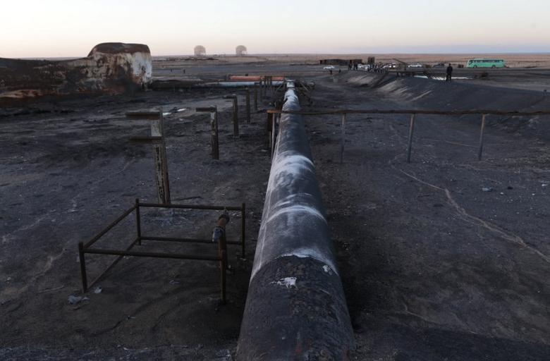 Damaged tanks and pipelines are seen at the oil port of Ras Lanuf, Libya January 11, 2017. Picture taken January 11, 2017. REUTERS/Esam Omran Al-Fetori