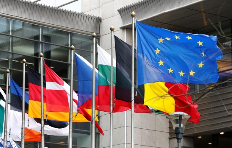 European and national flags fly outside the European Parliament in Brussels, Belgium, March 1, 2017. REUTERS/Yves Herman