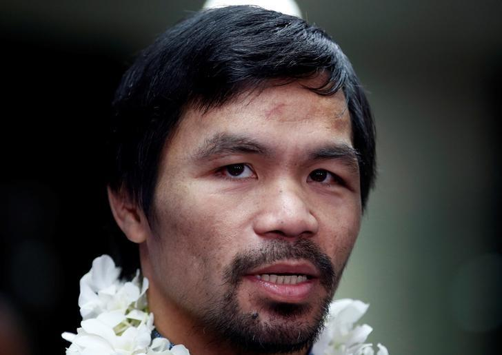Filipino boxer and Senator Manny Pacquiao speaks during a news conference upon arrival, after winning WBO welterweight bout with Jessie Vargas, at Ninoy Aquino International airport in Paranaque, Metro Manila in the Philippines, November 8, 2016.  REUTERS/Erik De Castro