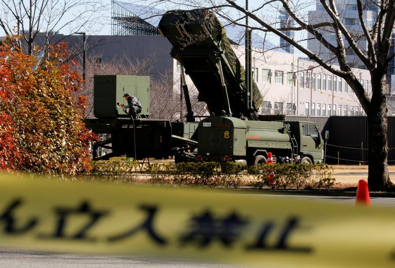 FILE PHOTO: A Japan Self-Defense Forces soldier works at a unit of Patriot Advanced Capability-3 (PAC-3) missiles at the Defense Ministry in Tokyo, Japan, February 12, 2017. The words at the bottom read, ''Keep out''.     REUTERS/Toru Hanai/File Photo