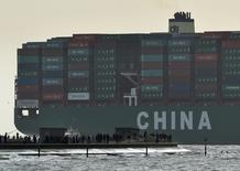 FILE PHOTO: Onlookers watch from a harbour wall as the largest container ship in world, CSCL Globe, docks during its maiden voyage, at the port of Felixstowe in south east England, January 7, 2015.  REUTERS/Toby Melville/File Photo