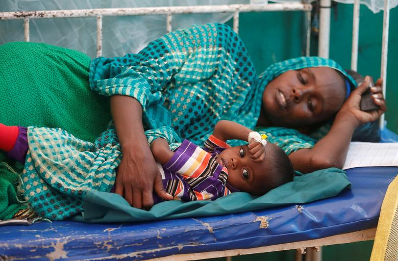 An internally displaced Somali woman holds her child receiving treatment inside a ward dedicated for diarrhoea patients at the Banadir hospital in Mogadishu. REUTERS/Feisal Omar