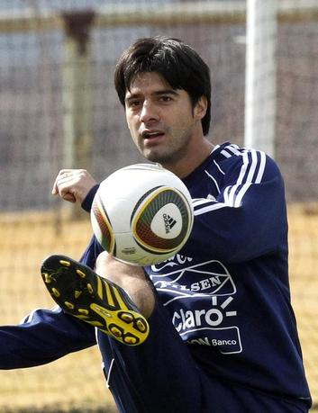 Paraguay's Julio Cesar Caceres kicks the ball during a training session session in Irene near Pretoria, July 1, 2010. REUTERS/Thomas Mukoya