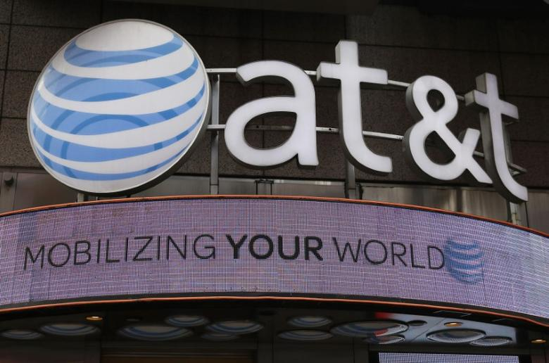 The signage for an AT&T store is seen in New York October 29, 2014. REUTERS/Shannon Stapleton/Files