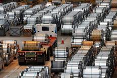 Рулоны стали на заводе  China Steel Corporation. Инфляция цен производителей в Китае в феврале ускорилась максимально почти за девять лет и превысила прогнозы, поскольку цены на сталь и другое сырье продолжили уверенное ралли, поддержав прибыль промышленных компаний мира.  REUTERS/Tyrone Siu