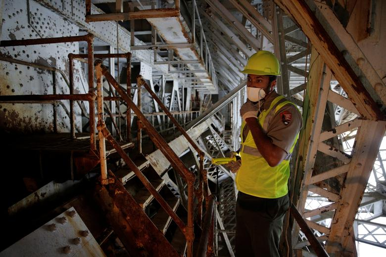 FILE PHOTO: Aaron LaRocca, Chief of Staff of the George Washington Memorial Parkway, looks at a trunnion post that needs replacement under the draw span on the Arlington Memorial Bridge in Washington, DC, U.S. on June 20, 2016.      REUTERS/Joshua Roberts/File Photo