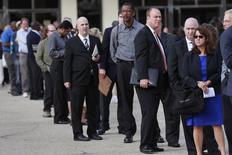 People wait in line to enter the Nassau County Mega Job Fair at Nassau Veterans Memorial Coliseum in Uniondale, New York, U.S. October 7, 2014. REUTERS/Shannon Stapleton/File Photo