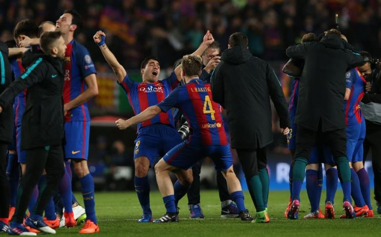 Football Soccer - Barcelona v Paris St Germain - UEFA Champions League Round of 16 Second Leg - The Nou Camp, Barcelona, Spain - 8/3/17 Barcelona's Lionel Messi and Ivan Rakitic celebrate after the game  Reuters / Albert Gea Livepic