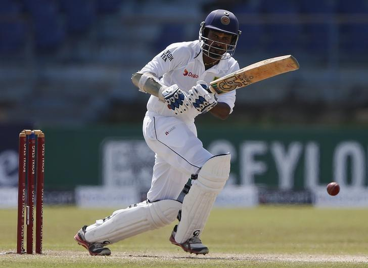 FILE PHOTO - Sri Lanka's Upul Tharanga plays a shot during the third day of their first test cricket match against South Africa in Galle July 18, 2014. REUTERS/Dinuka Liyanawatte