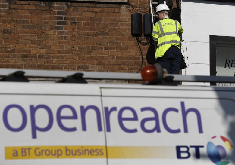 A BT openreach engineer works on a telephone line in Manchester northern England, March 17, 2016. REUTERS/Phil Noble