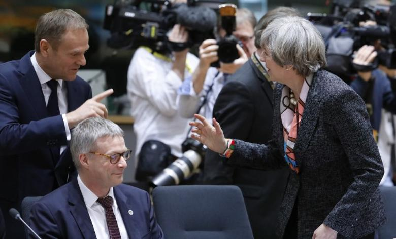 British Prime Minister Theresa May and EU Council President Donald Tusk (upper left) attend the EU summit in Brussels, Belgium, March 9, 2017.    REUTERS/Yves Herman