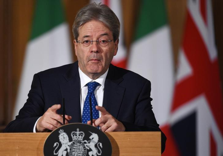 Italy's Prime Minister Paolo Gentiloni holds a press conference with his counterpart from Britain Theresa May (not shown) at Number 10 Downing Street in London, February 9, 2017. REUTERS/Facundo Arrizabalaga