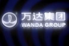 A sign of Dalian Wanda Group in China glows during an event announcing strategic partnership between Wanda Group and FIFA in Beijing, China March 21, 2016. REUTERS/Damir Sagolj/File Photo