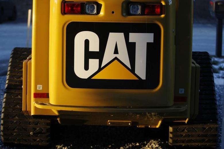 The CAT logo is seen on the back of a Caterpillar machine on a lot at Milton CAT in North Reading, Massachusetts January 23, 2013. REUTERS/Jessica Rinaldi