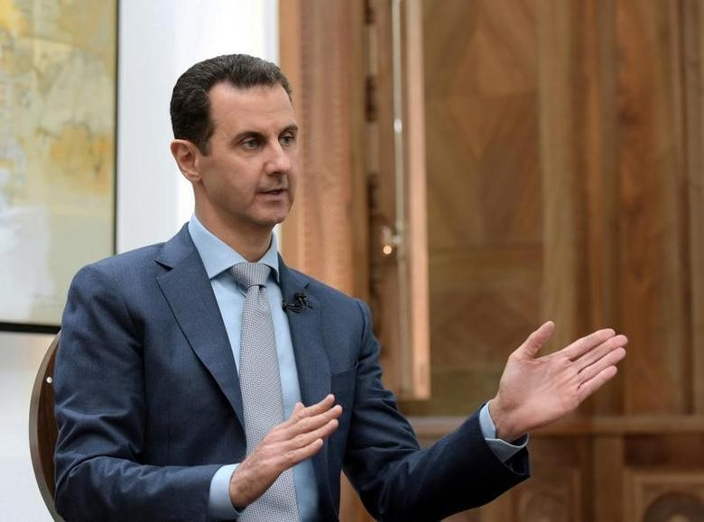 Syria's President Bashar al-Assad speaks during an interview with Yahoo News in this handout picture provided by SANA on February 10, 2017, Syria.  SANA/Handout via REUTERS/Files