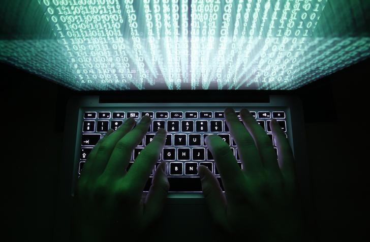 A man types on a computer keyboard in Warsaw in this February 28, 2013 illustration file picture. One of the largest ever cyber attacks is slowing global internet services after an organisation blocking ''spam'' content became a target, with some experts saying the disruption could get worse.        To match INTERNET-ATTACK/      REUTERS/Kacper Pempel/Files (POLAND - Tags: BUSINESS SCIENCE TECHNOLOGY) - RTXXZVX