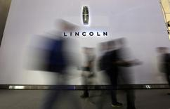 Visitors walk past a logo of Lincoln at Auto China 2014 in Beijing April 20, 2014. REUTERS/Jason Lee
