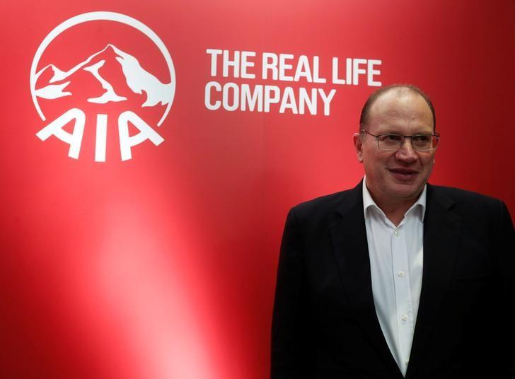 AIA Group Chief Executive and President Mark Tucker poses during a news conference on the company's annual results in Hong Kong, China February 24, 2017.      REUTERS/Bobby Yip