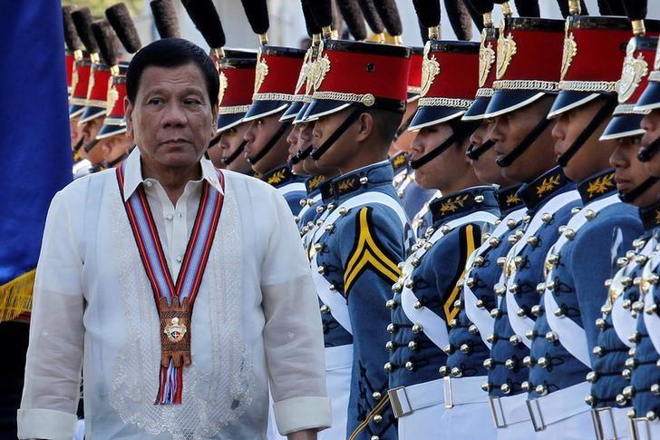Philippine President Rodrigo Duterte walks past cadets to attend graduation ceremonies at the Philippine Military Academy in Baguio city, in northern Philippines March 12, 2017.    REUTERS/Harley Palangchao