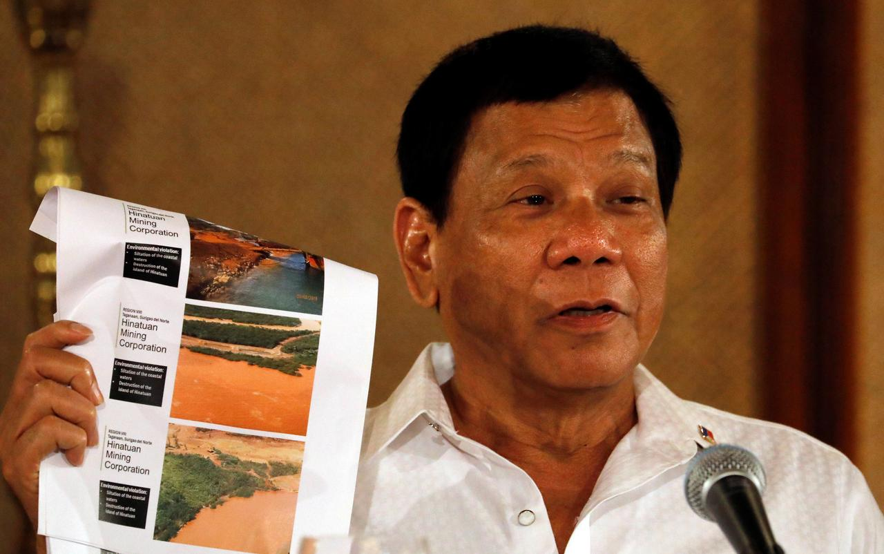 Philippines' Duterte wants mining ban, links miners to