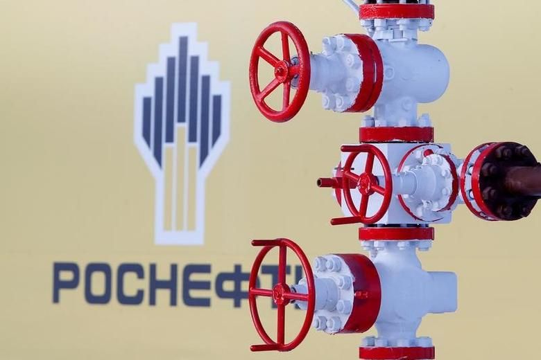 The logo of Russian state oil company Rosneft is pictured behind a pipe at the Samotlor oil field outside the of Nizhnevartovsk, Russia, January 26, 2016.  REUTERS/Sergei Karpukhin/File Photo