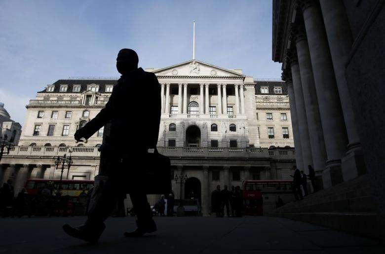 A man walks in front of the Bank of England in the City of London, Britain, November 3, 2016. REUTERS/Peter Nicholls