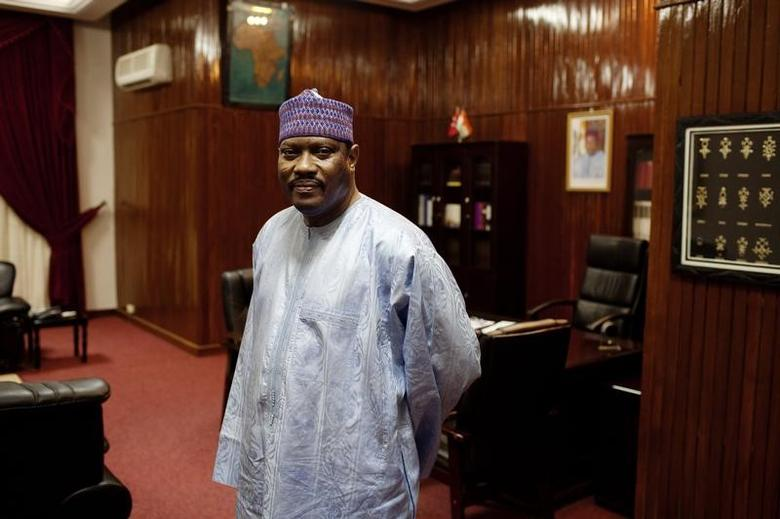 Hama Amadou poses for a picture at his office in the National Assembly in Niamey, September 16, 2013.  REUTERS/Joe Penney