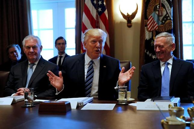 U.S. President Donald Trump (C), flanked by Secretary of State Rex Tillerson (L) and Defense Secretary James Mattis (R), holds a cabinet meeting at the White House in Washington, U.S. March 13, 2017. REUTERS/Jonathan Ernst