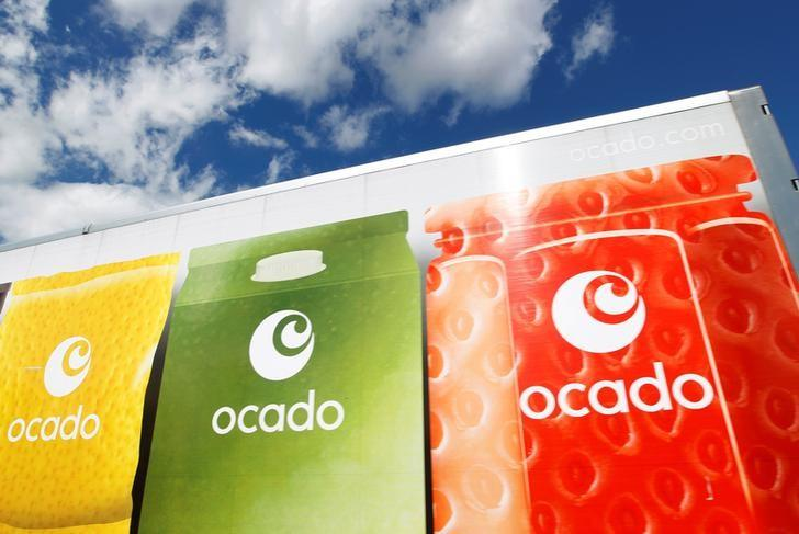 An Ocado truck returns to the Ocado depot in Hatfield, southern England July 21, 2010. REUTERS/Suzanne Plunkett/File Photo