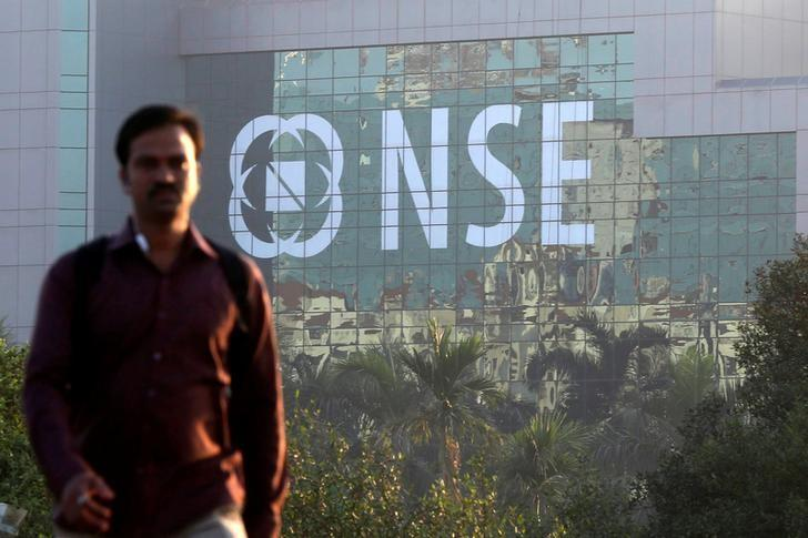 A man walks past the NSE (National Stock Exchange) building in Mumbai, India, December 27, 2016. Picture taken December 27, 2016. REUTERS/Shailesh Andrade/Files