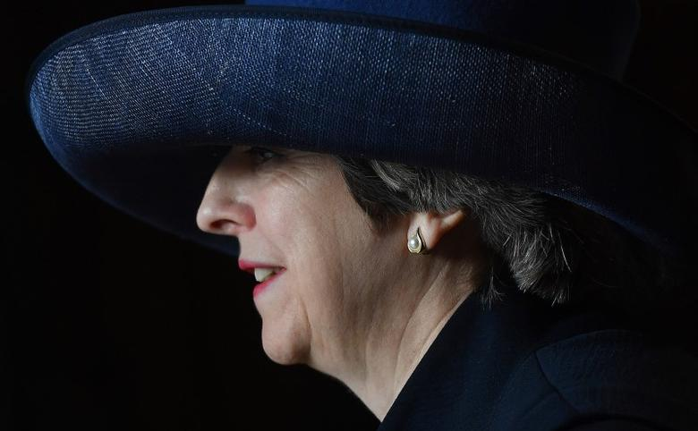 Britain's Prime Minister Theresa May leaves after attending a Commonwealth Day Service at Westminster Abbey in London, March13, 2017. REUTERS/Ben Stansall/Pool