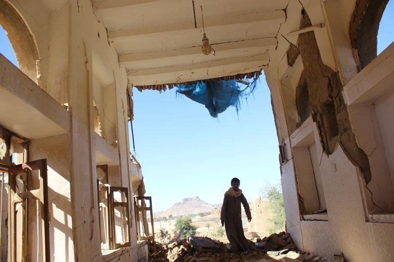 A boy walks inside a house destroyed by a recent Saudi-led air strike in the northwestern city of Saada, Yemen January 4, 2017. REUTERS/Naif Rahma