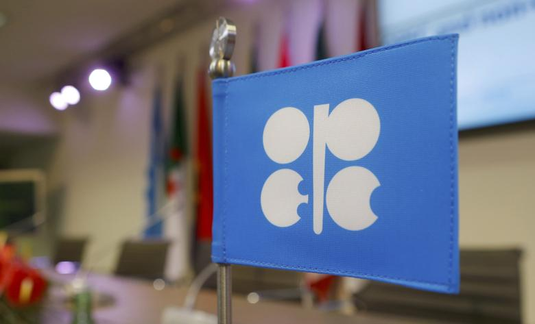 A flag with the Organization of the Petroleum Exporting Countries (OPEC) logo is seen before a news conference at OPEC's headquarters in Vienna, Austria, December 10, 2016. REUTERS/Heinz-Peter Bader/File Photo