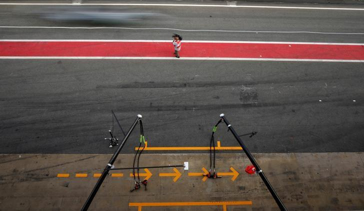 Formula One - F1 - Test session - Barcelona-Catalunya racetrack in Montmelo, Spain - 7/3/17. Ferrari's pit-stop place is pictured as Mercedes' Valteri Bottas drives past. REUTERS/Albert Gea/Files