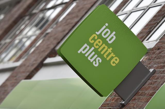 A Job Centre Plus sign is seen in central London, Britain, July 15, 2015.  REUTERS/Toby Melville/File Photo