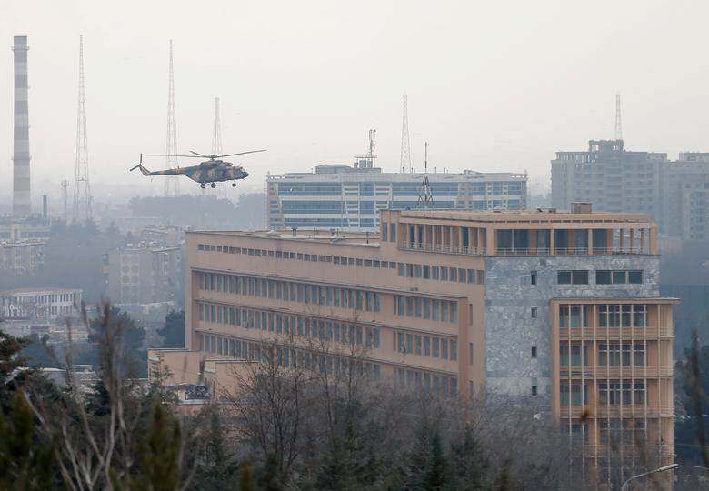 Afghan National Army (ANA) helicopter arrives to bring soldiers on a military hospital during gunfire and blast in Kabul, Afghanistan March 8, 2017.REUTERS/Mohammad Ismail