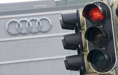 A red traffic light is seen in front of the Audi headquarters in Ingolstadt, Germany, March 15, 2017.     REUTERS/Lukas Barth