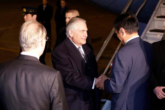 U.S. Secretary of State Rex Tillerson, second left, is welcomed by Parliamentary Vice-Minister for Foreign Affairs Shunsuke Takei as he arrives during his first trip to Asia as Secretary, at Haneda International Airport in Tokyo, Wednesday, March 15, 2017. REUTERS/Eugene Hoshiko/Pool