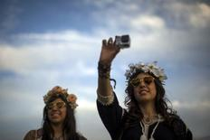 Women record GoPro video at the Coachella Valley Music and Arts Festival in Indio, California April 10, 2015. REUTERS/Lucy Nicholson