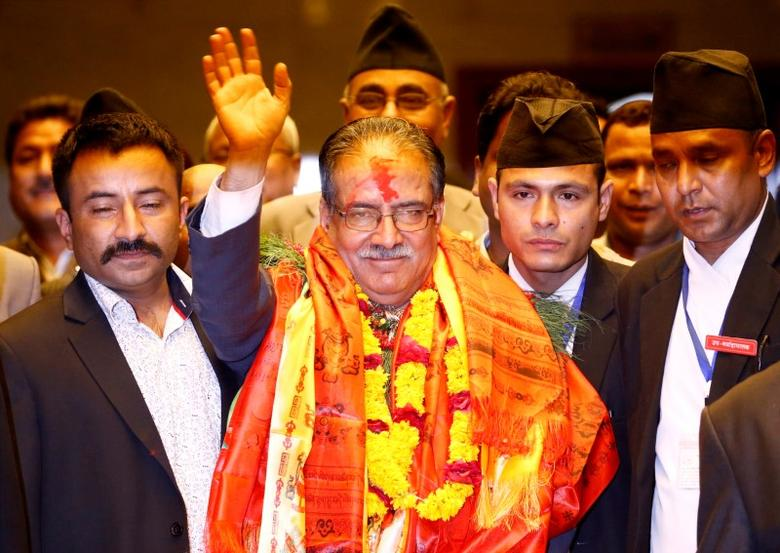 Nepal Prime Minister Pushpa Kamal Dahal, also known as Prachanda, waves towards the media after he was elected Nepal's 24th prime minister in 26 years, in Kathmandu, Nepal, August 3, 2016. REUTERS/Navesh Chitrakar/Files