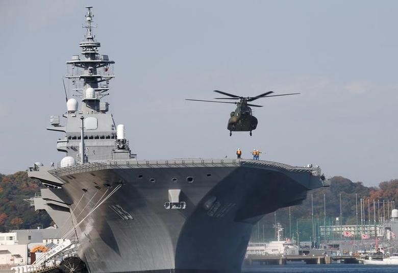 FILE PHOTO: A helicopter lands on the Izumo, Japan Maritime Self Defense Force's (JMSDF) helicopter carrier, at JMSDF Yokosuka base in Yokosuka, south of Tokyo, Japan, December 6, 2016. REUTERS/Kim Kyung-Hoon/File Photo