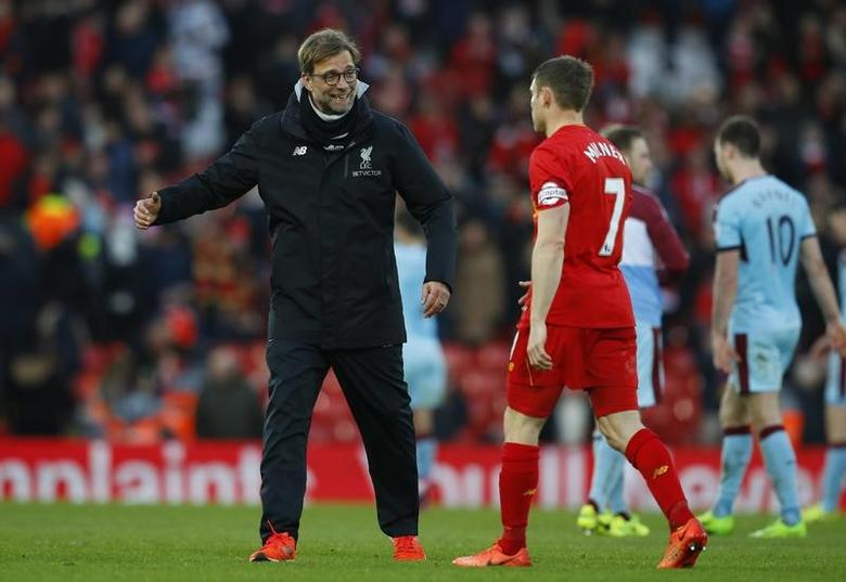 Liverpool manager Juergen Klopp and James Milner celebrate after the game  Reuters / Phil Noble Livepic