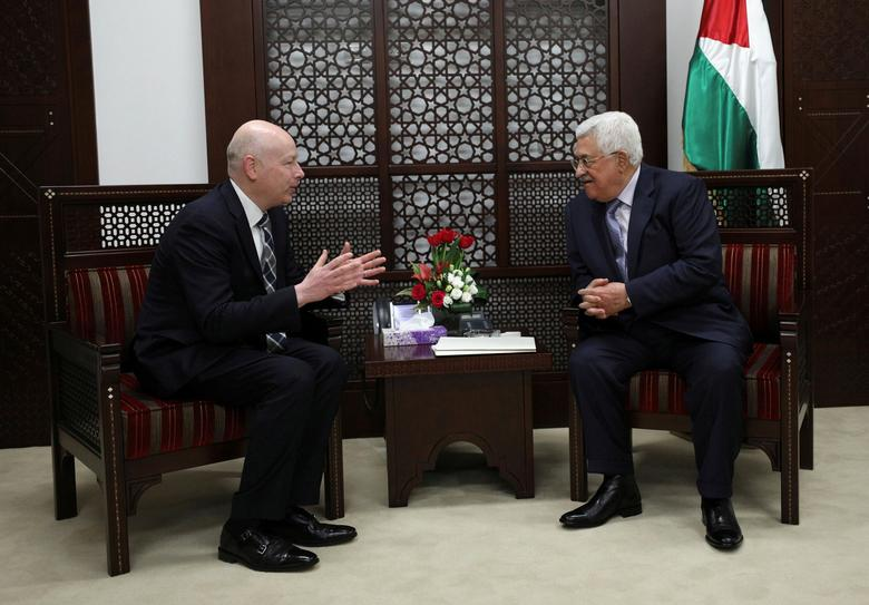 Palestinian President Mahmoud Abbas (R) meets with Jason Greenblatt, U.S. President Donald Trump's Middle East envoy, in the West Bank city of Ramallah March 14, 2017. REUTERS/Mohamad Torokman/Files