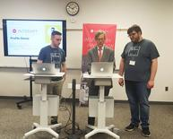 Earl Gohl (C), co-director of the Appalachian Regional Commission, is participating in a coding demo with Interapt trainees in Paintsville, Kentucky, U.S. on March 13, 2017.    REUTERS/Valerie Volcovici