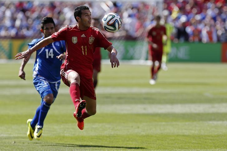 Jun 7, 2014; Landover, MD, USA; Spain midfielder Pedro Rodriguez (11) receives a pass in front of El Salvador forward Andres Flores (14) in the first half at FedEx Field. Spain won 2-0. Mandatory Credit: Geoff Burke-USA TODAY Sports