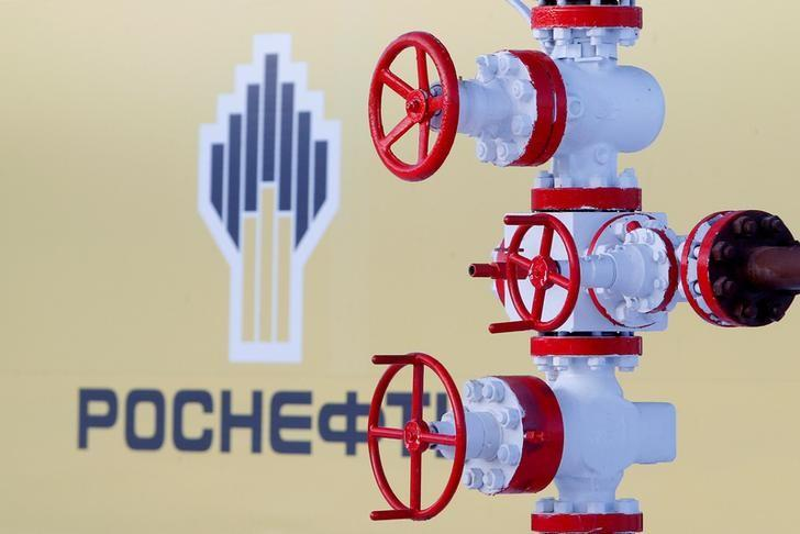 FILE PHOTO: The logo of Russian state oil company Rosneft is pictured behind a pipe at the Samotlor oil field outside the of Nizhnevartovsk, Russia, January 26, 2016. REUTERS/Sergei Karpukhin/File Photo