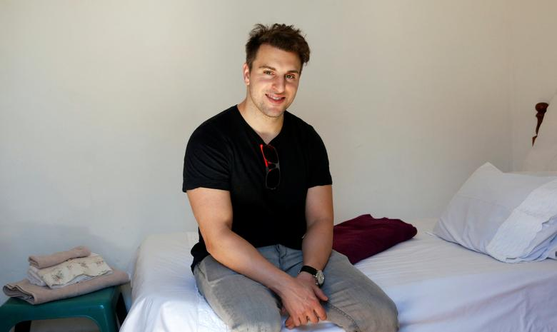 Co-founder and CEO of Airbnb Brian Chesky sits on a bed at a bed and breakfast in Langa township, Cape Town, South Africa March 17, 2017. REUTERS/Mike Hutchings