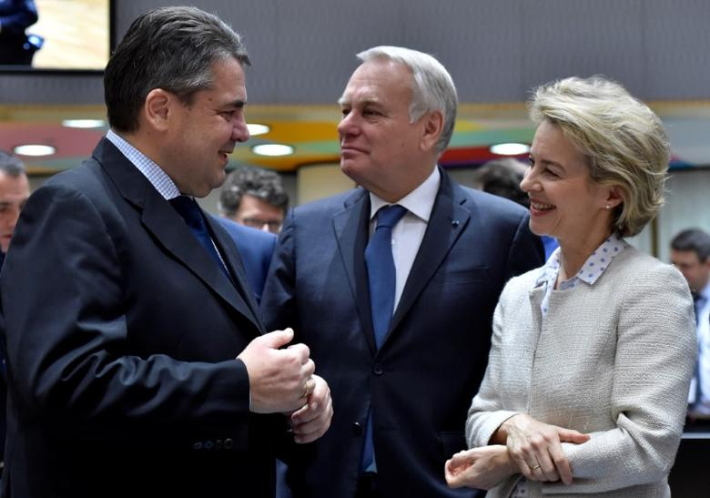 German Defence Minister Ursula von der Leyen (R) and French Foreign Minister Jean-Marc Ayrault (C) listen to German Foreign Minister Sigmar Gabriel during a joint meeting of European Union foreign and interior ministers at the EU Council in Brussels, Belgium March 6, 2017. REUTERS/Eric Vidal