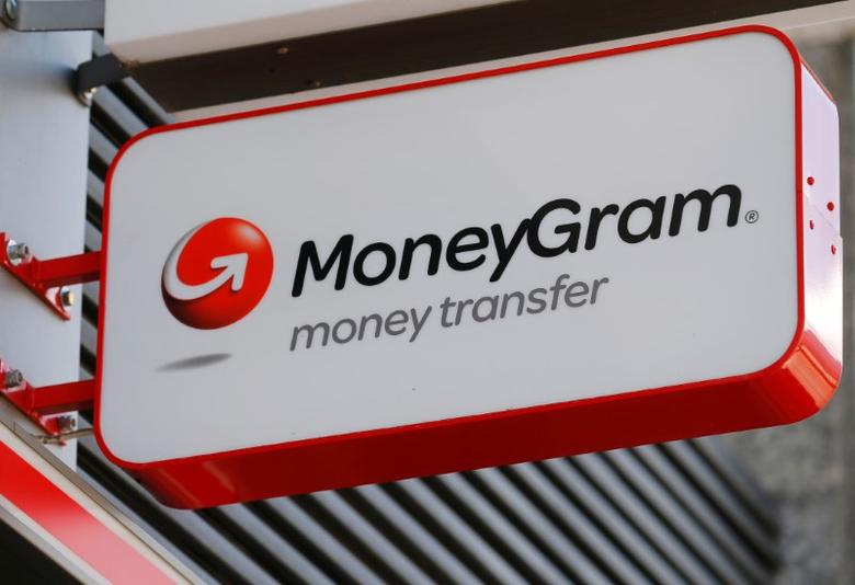 A Moneygram logo is seen outside a bank in Vienna, Austria, June 28, 2016. REUTERS/Heinz-Peter Bader